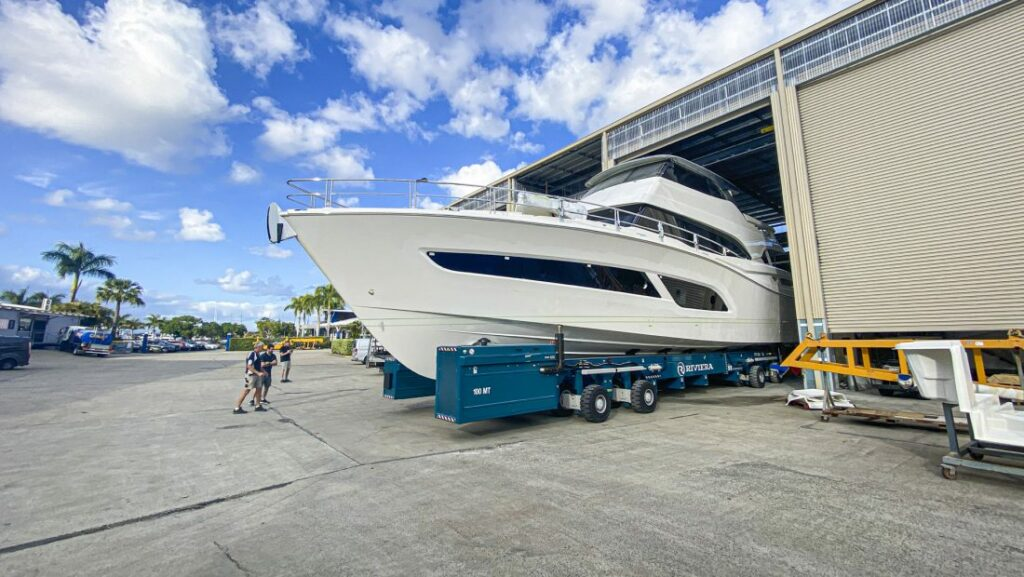 Riviera 78 Motor Yacht being moved from warehouse facility