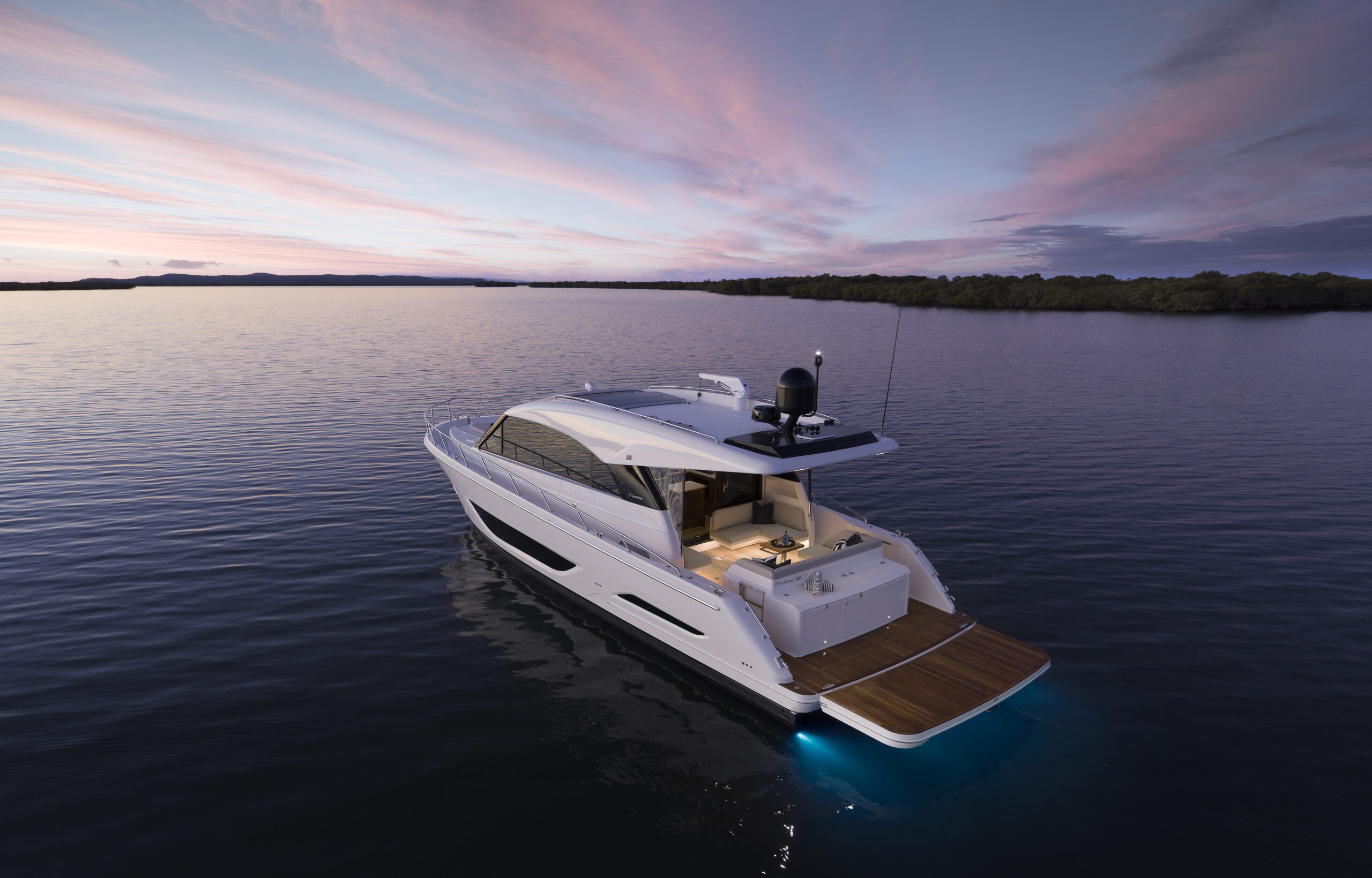 Maritimo S55 anchored from rear with sun setting