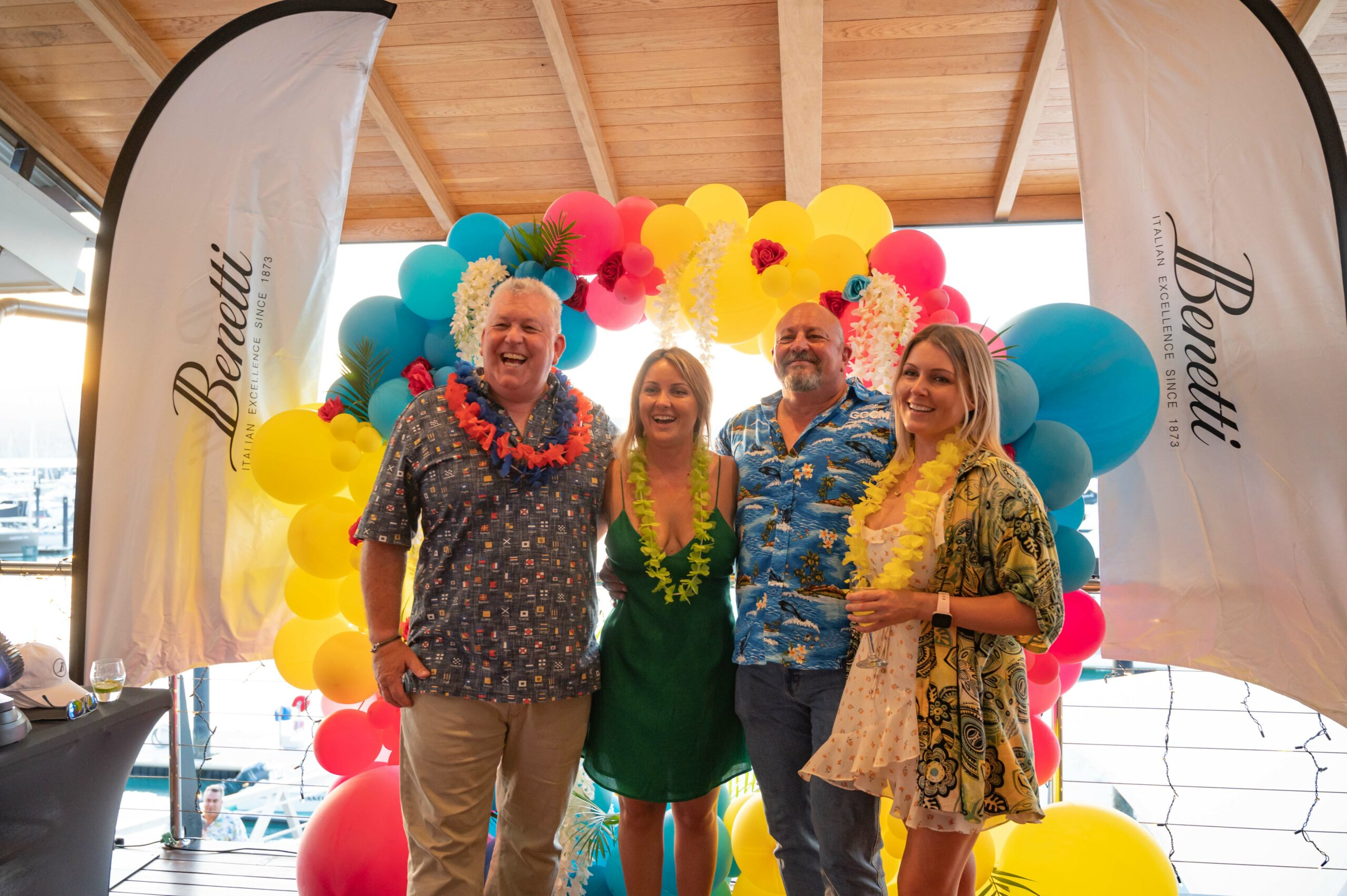 Guests enjoying the Queensland event in tropical clothes