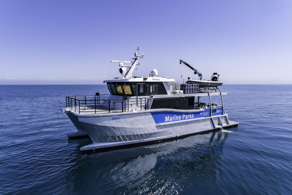 Catamaran MV Tamoya anchored at sea