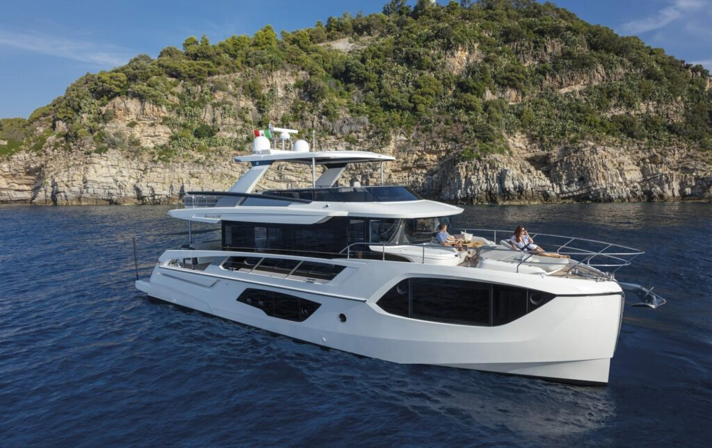 Absolute Navetta anchored with island in background